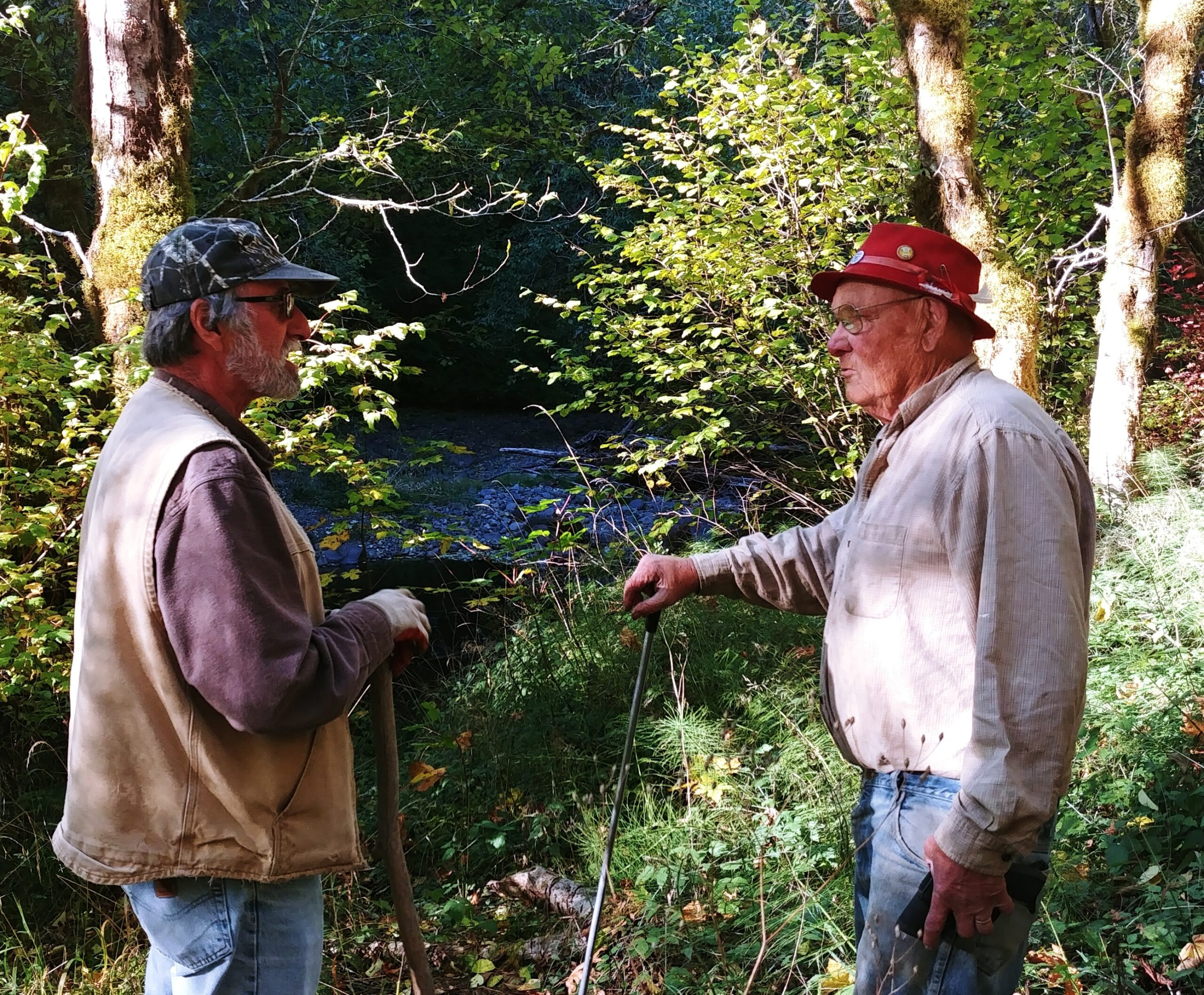 Man Volunteering along a creek with Pudding River Watershed